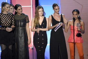 Courtney Eaton, Riley Keough, Rosie Huntington-Whiteley, and Zoe Kravitz – who star in Mad Max: Fury Road as Immortan Joe's five slave-wives – accept the Critics' Choice award for best director, on George Miller's behalf
