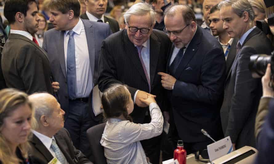 Greta Thunberg shakes Jean-Claude Juncker's hand