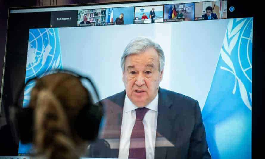 Antonio Guterres is seen on a screen during the video conference of the Petersberg Climate Dialogue in Berlin.