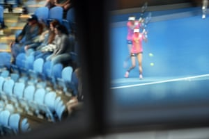 Ekaterina Makarova is seen in a reflection during her match against Johanna Konta.