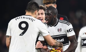 Aboubakar Kamara (right) argues with Aleksandar Mitrovic over the taking of a penalty during Fulham's 1-0 victory over Huddersfield last month