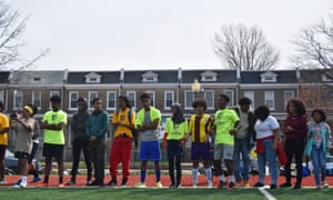 Teenagers watch a game during a soccer tournament in Washington.