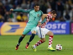 Portugal's Cristiano Ronaldo tussles with Croatia's Darijo Srna.