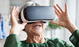 An older woman using VR glasses