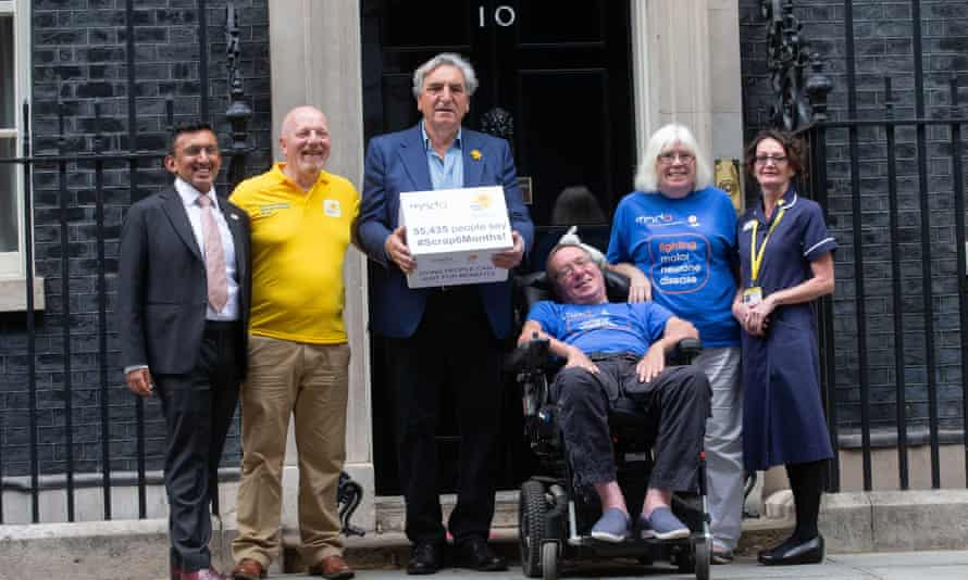 The actor Jim Carter and others handing a petition to Downing Street in 2019 urging a law change to enable more terminally ill people to get quicker access to benefits