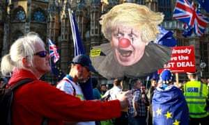 Anti-Brexit protester carrying poster of Boris Johnson in clown makeup
