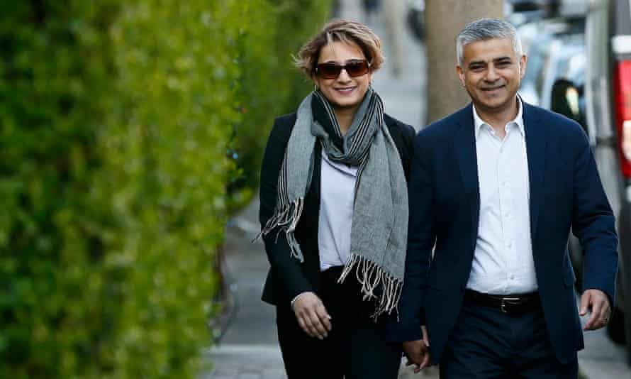 Sadiq Khan and his wife, Saadiya, arrive to cast their votes in the local elections, in Tooting, south London.