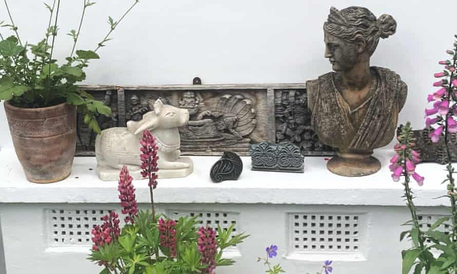 Up in the air: flowers and figures on the roof terrace make it a serene space.