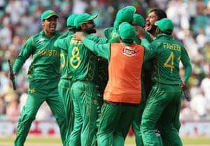 Pakistan celebrate winning the match.