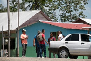 Central American migrants try to agree a price with a local smuggler for the journey from Frontera Corozal to Palenque, Chiapas.