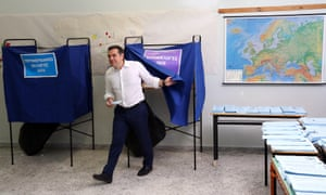 Greek prime minister Alexis Tsipras leaves the polling station after voting on Sunday.