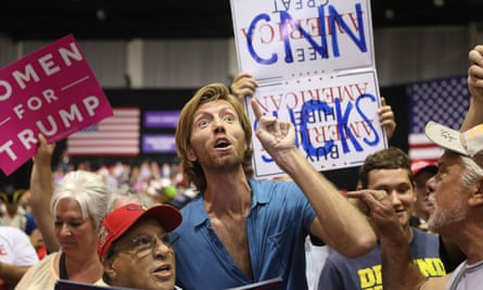 A 'CNN sucks' sign at a Trump rally in Tampa on Tuesday night. Trump has intensified his criticism of the media and embraced the hostile attitude among his supporters towards members of the press.