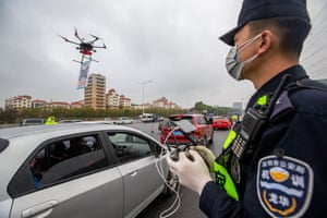 Eye in the sky … a Chinese police officer employs a drone in Shenzhen to track vehicle movements.