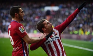 Antoine Griezmann strikes a pose as he celebrates after scoring the opening goal against Real Madrid.