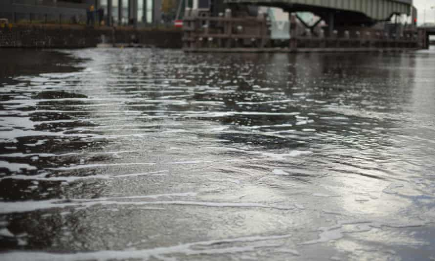 A curtain of tiny air bubbles is all that is evident of the barrier which stretches 60m diagonally across the canal.