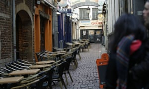 Tourists look down a side street off the normally bustling Rue des Bouchers in central Brussels