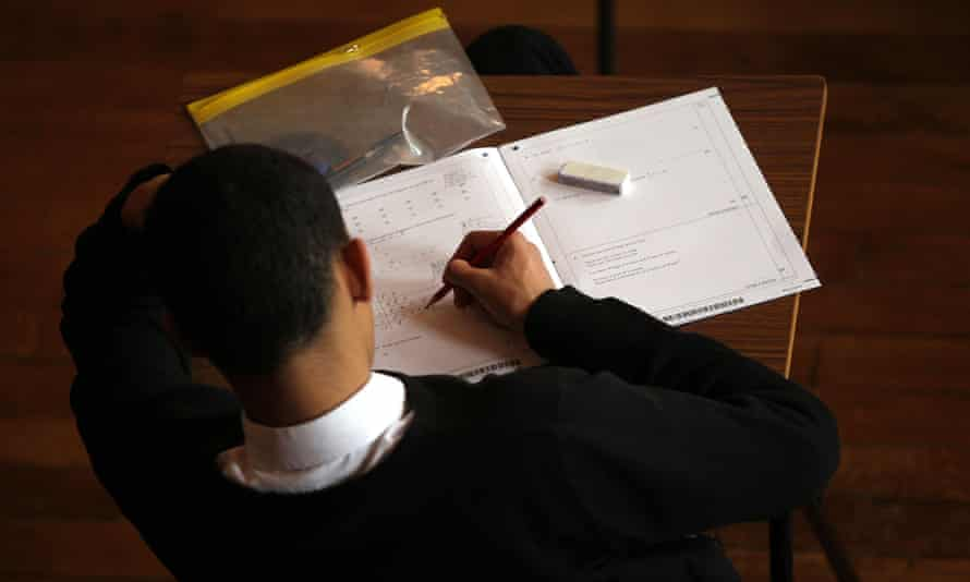 A child sits an exam.