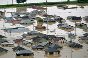 The Mabicho area is submerged after Odagawa River banks collapse due to heavy rain in Okayama, Japan.