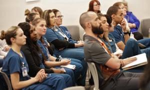 Nursing students listen during a special meeting of the Arizona nursing board special in Phoenix, regarding events at Hacienda HealthCare.