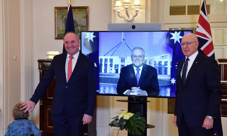 Re-elected leader of the Nationals Barnaby Joyce and son Thomas (left) pose for photographs with PM Scott Morrison (centre) after being sworn in by Australia's governor general David Hurley (right) on Tuesday morning.