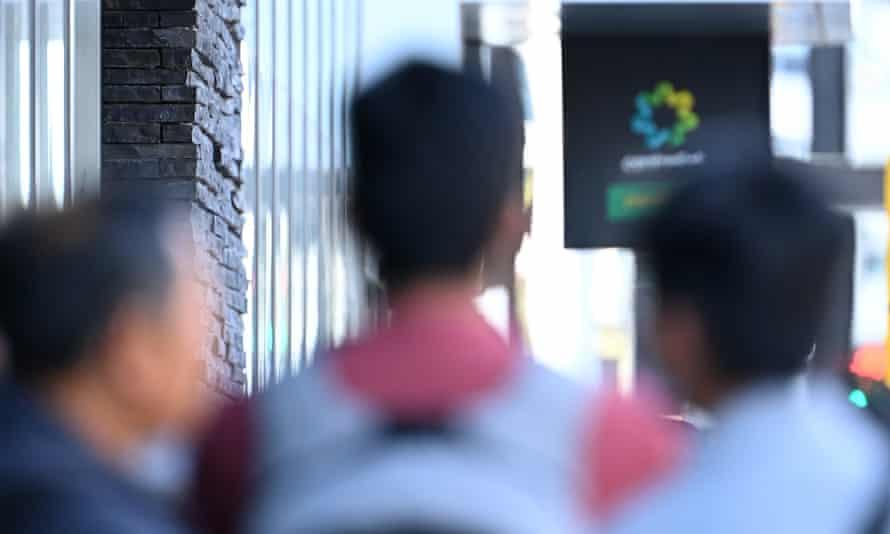 People queue to enter Centrelink in Melbourne.