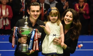 Mark Selby poses for a photograph with with his daughter Sofia Maria, wife Vikki and the World Snooker Championship trophy.