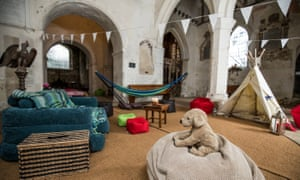 Interior of St Peter and St Paul, Albury Park, Surrey, with toys and bunting strewn around.
