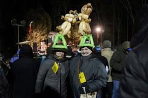 Jennifer Koch of Philadelphia and Angela Guldin of Sinking Spring, PA, wear custom-made balloon hats