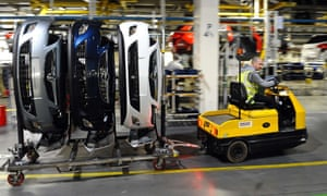 Vehicle parts for Astra cars are transported on the production line at the Vauxhall factory in Ellesmere Port.