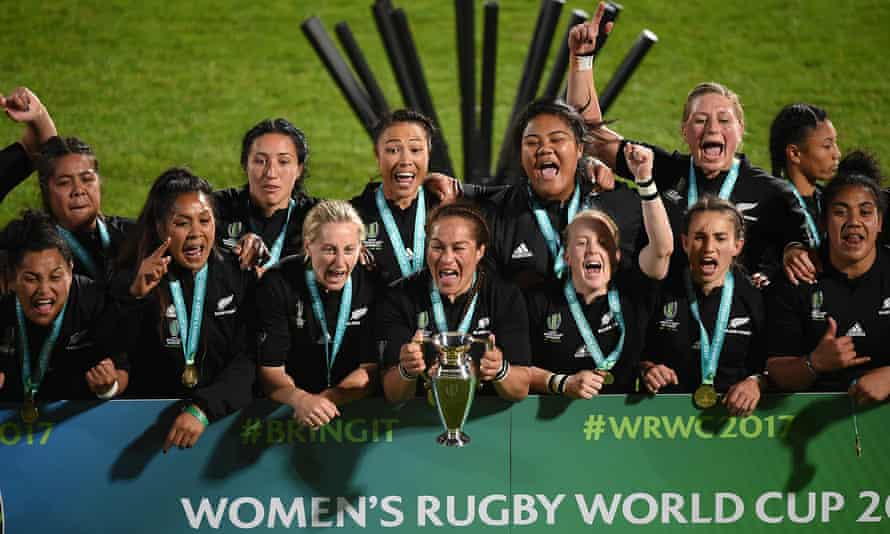 New Zealand players lift the trophy after a dramatic encounter.