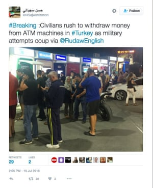 People rush to ATM machines to withdraw money.