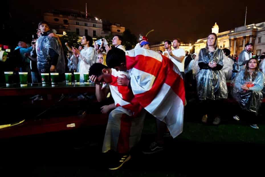Fans watch England v Italy in Trafalgar Square.
