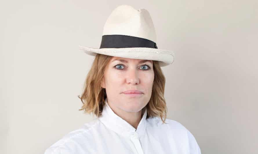 Cerys Matthews wearing a hat and white shirt