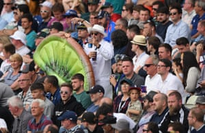 New Zealand fans holding an inflatable Kiwi celebrate a boundary.