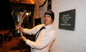 Phillip Gate shows off his prize outside the Bridge Inn.