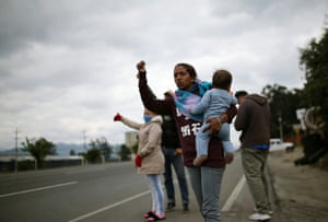 Venezuelan migrants in Chia, Colombia, try to catch a ride to get home after Colombia's government-imposed quarantine mad it impossible for them to earn a living