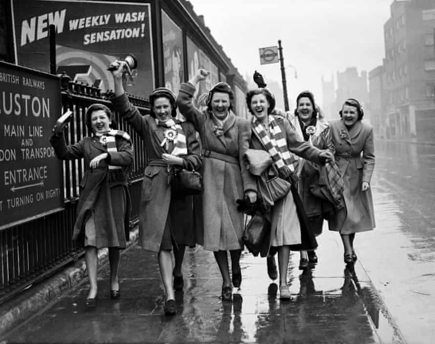 A downpour could not dampen the enthusiasm of these Liverpool supporters as they toured London before the 1950 FA Cup final between Arsenal and Liverpool.