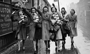 Women in Liverpool walk down the street in 1950