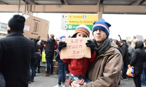 Thousands gathered at Terminal Four at JFK Airport to protest the detention of several travelers who had valid visas when embarking upon their flights.