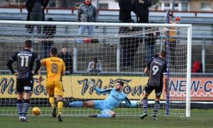 Chris Porter equalises for Colchester from the penalty spot.