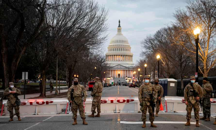 The scene in Washington on Sunday. At least two active-duty service members or national guard members have been arrested in connection with the Capitol assault.