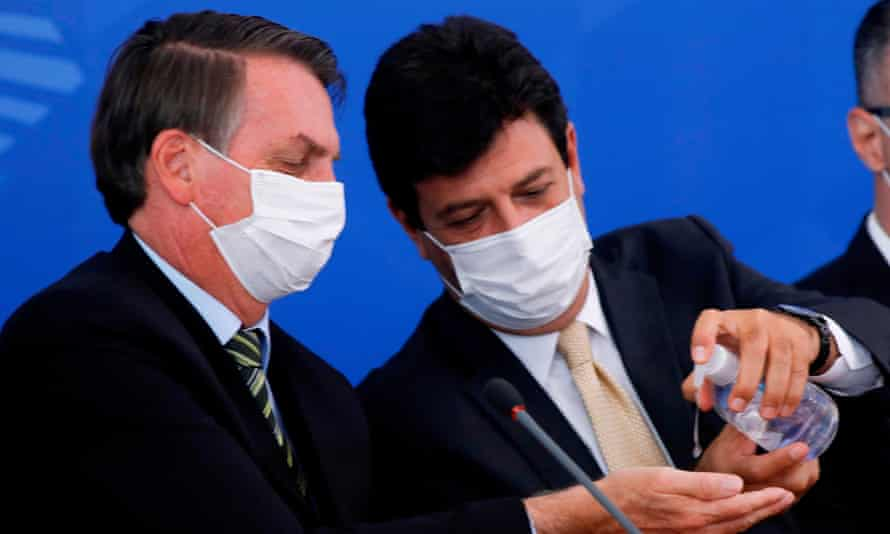 Luiz Henrique Mandetta with Bolsonaro at a press conference on 18 March. Mandetta said of Brazilians: 'They don't know whether to listen to the health minister or the president.'