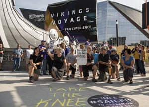 Protestors kneel outside US Bank Stadium before the Minnesota Vikings game against the Tampa Bay Buccaneers in Minneapolis.