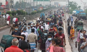 People in Bangladesh walking to their destination as vehicles are stopped as authorities enforced a strict lockdown to combat a much deadlier second wave of the Covid-19 coronavirus infection in Dhaka.
