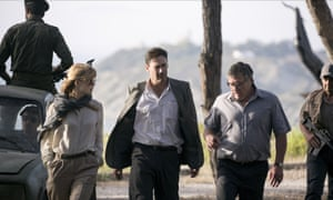 Western perspective … from left, Rosamund Pike, Jon Hamm and Dean Norris in The Neogtiator