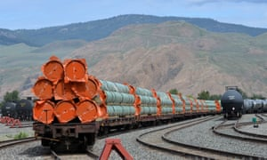 Steel pipe to be used in the pipeline construction of Canada's Trans Mountain expansion project sits on rail cars at a stockpile site in Kamloops, British Columbia.