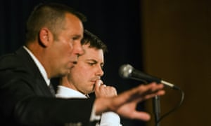 The South Bend police chief, Scott Ruszkowski, left, speaks as Buttigieg listens during the town hall meeting.