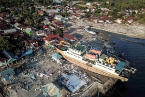 A ship is seen stranded on the shore after an earthquake and tsunami hit the area in Wani, Donggala, Central Sulawesi.