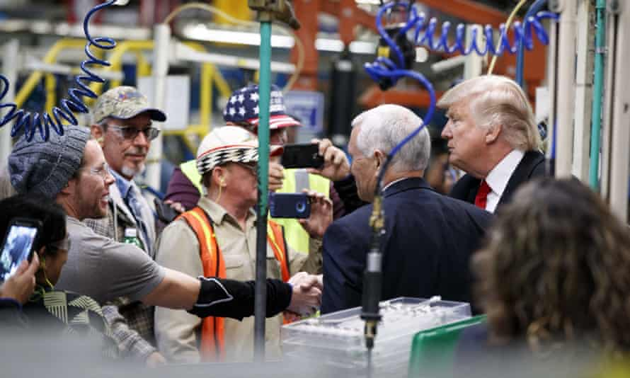 Donald Trump and Mike Pence talk with factory workers during a visit to the Carrier factory.