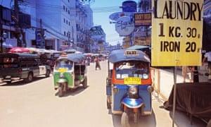 Tuk Tuks on a busy toutist street in Thailand